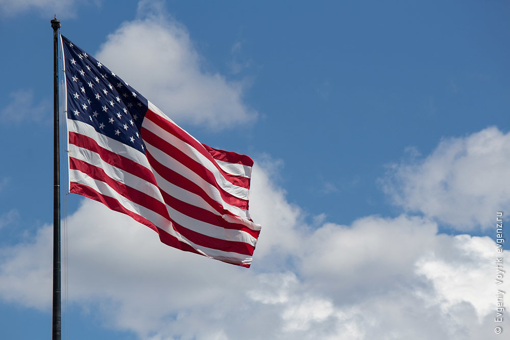 Flag of United States of America (USA) waving in the wind with b