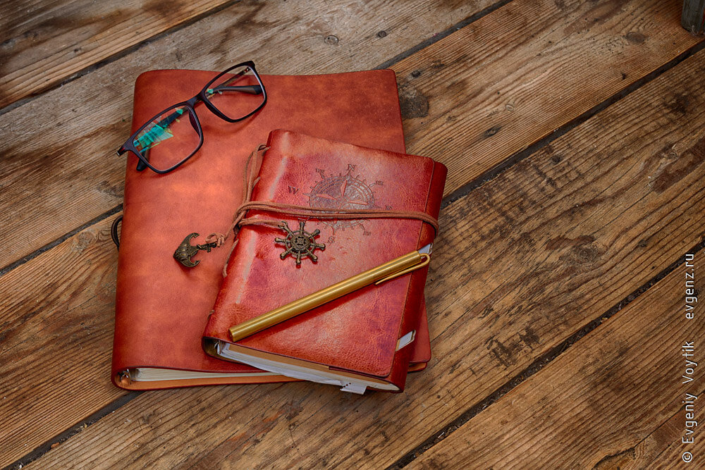 Vintage writing materials still life: two brown leather vintage